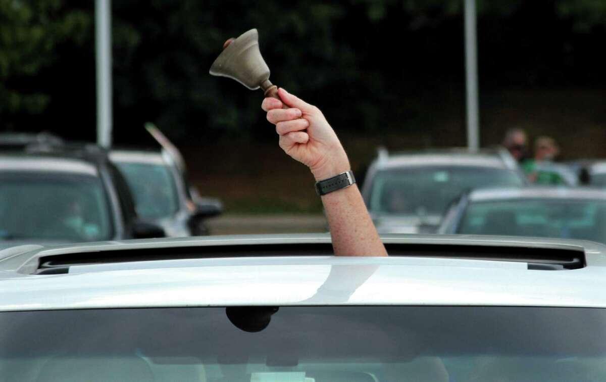 A teacher rigs a bell during a