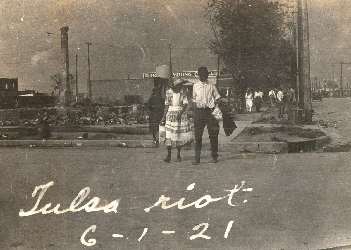 """1921: The Black Wall Street massacre Coined """"Black Wall Street,"""" this booming Black community in the Greenwood district of Tulsa, Oklahoma, was one of the most self-sustaining, financially prosperous communities in the early 20th century. At the end of May in 1921, white lynch mobs, some weaponized by city officials, bombed and brutalized the Black residents and businesses in the town, destroying the community with severe violence toward Black men, women, and children. The incident is described by historians as """"the single worst incident of racial violence in American history."""" [Pictured: The streets of Tulsa with smoke rising in the background photographed on June 1, 1921.]"""