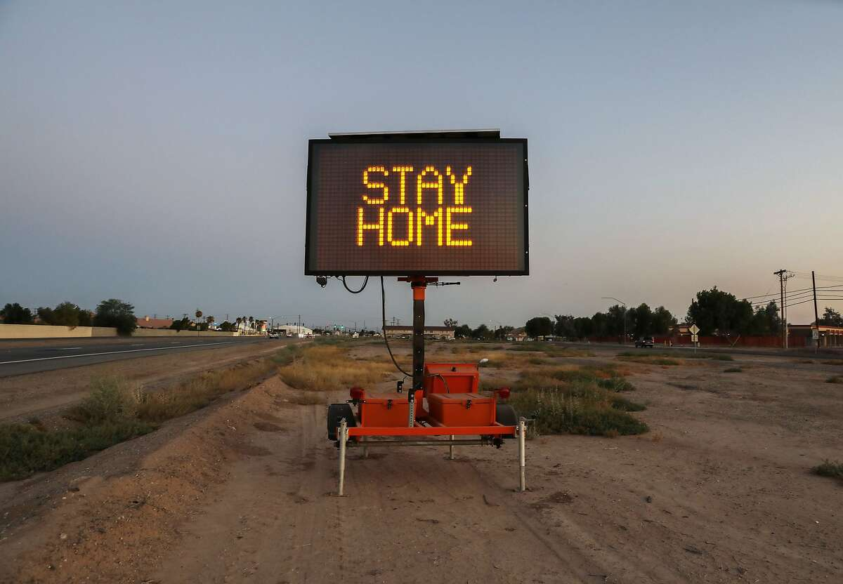 EL CENTRO, CALIFORNIA - JULY 23: A message is posted reading 'Stay Home' in Imperial County which has been hard-hit by the COVID-19 pandemic on July 23, 2020 in El Centro, California. Imperial County currently suffers from the highest death rate and near-highest infection rate from COVID-19 in California. The rural county, which is 85 percent Latino, borders Mexico and Arizona and endures high poverty rates and air pollution while also being medically underserved. In California, Latinos make up about 39 percent of the population but account for 55 percent of confirmed coronavirus cases. (Photo by Mario Tama/Getty Images)