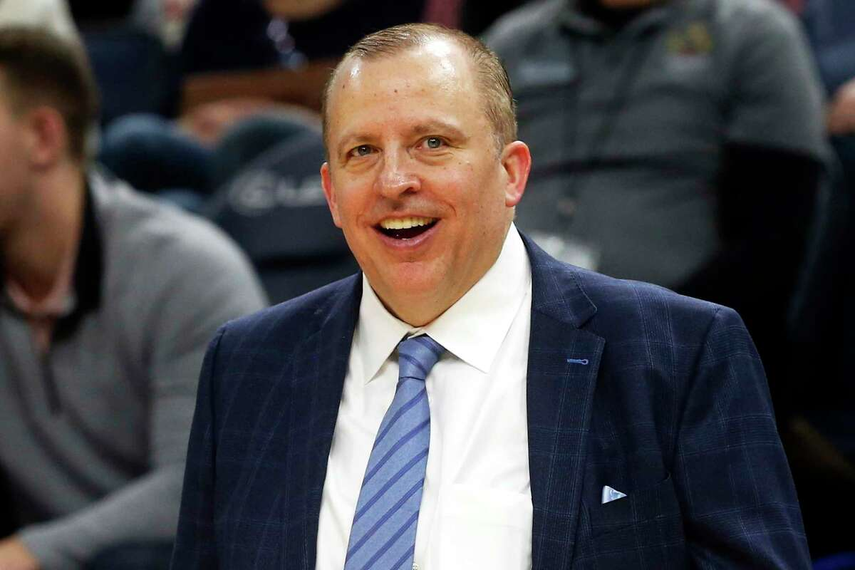 FILE - In this Jan. 4, 2019, file photo, Minnesota Timberwolves head coach Tom Thibodeau smiles in the waning moments as his team defeats the Orlando Magic in an NBA basketball game in Minneapolis. Thibodeau is back in New York as the Knicksa€™ new coach. The former NBA Coach of the Year was hired Thursday, July 30,2020, returning to the team he helped lead to the NBA Finals as an assistant coach. (AP Photo/Jim Mone, File)