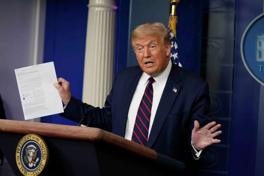 President Donald Trump holds an article as he speaks during a news conference at the White House, Thursday, July 30, 2020, in Washington. (AP Photo/Evan Vucci) Photo: Evan Vucci / Copyright 2020 The Associated Press. All rights reserved