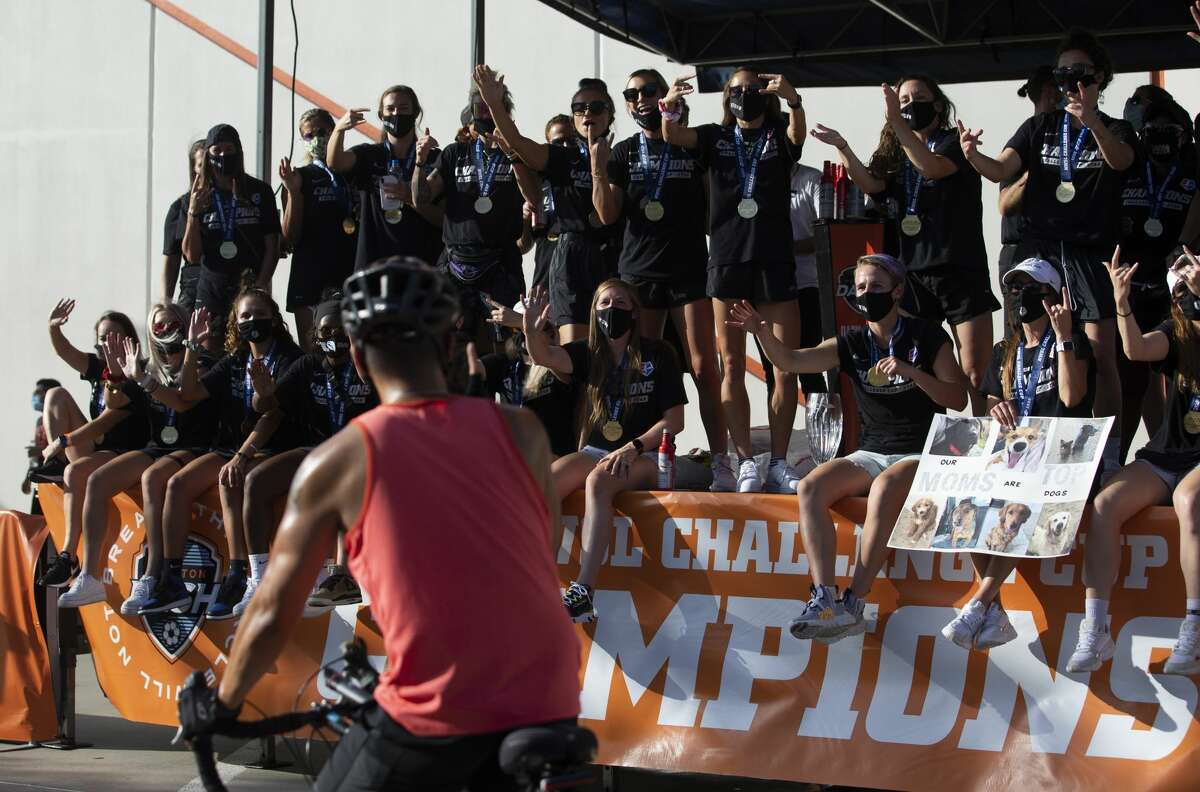 Houston Dash fans elebrate the team's NWSL Challenge Cup Championship at a drive-thru setting Thursday, July 30, 2020, outside BBVA Stadium in Houston.