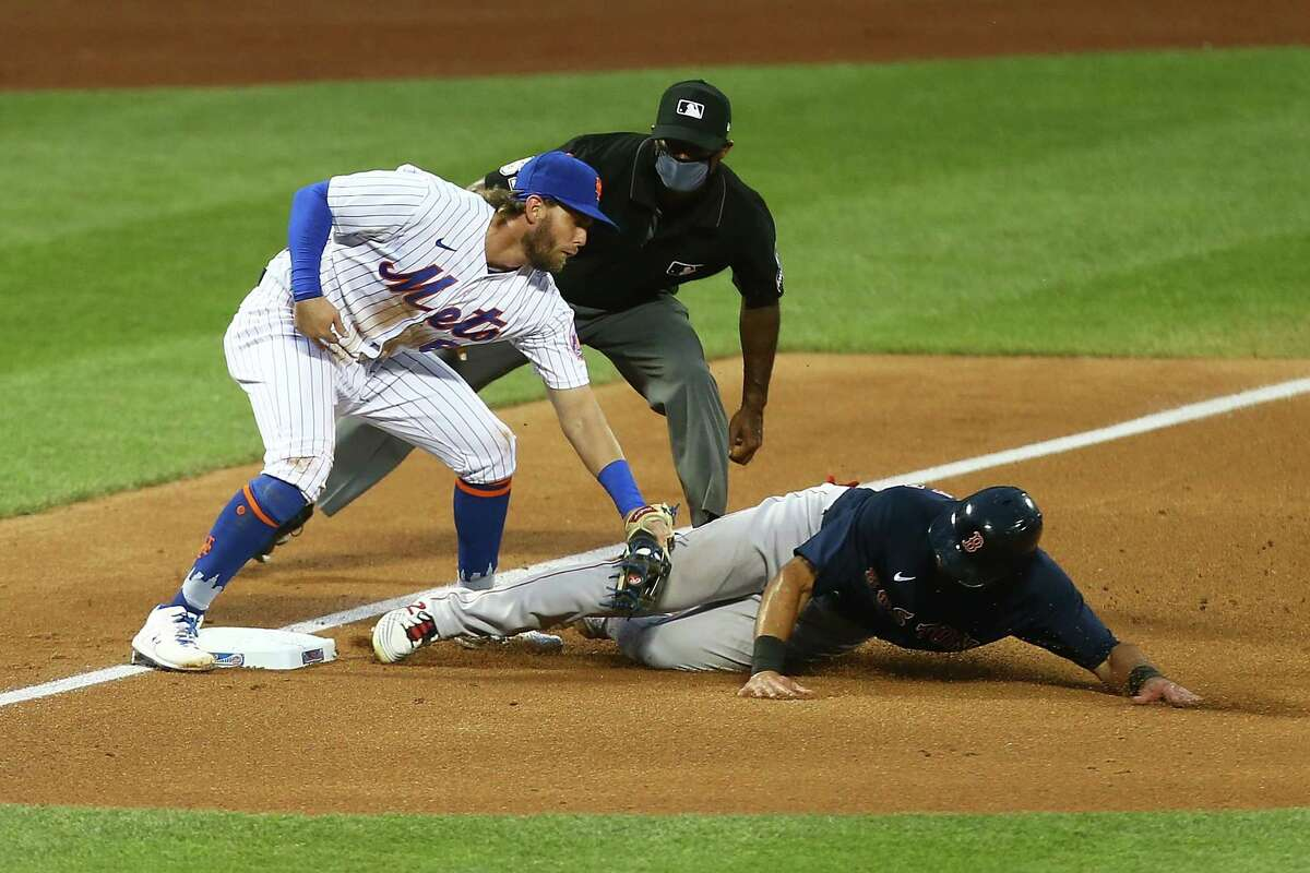NEW YORK, NEW YORK - JULY 30: Jeff McNeil #6 of the New York Mets tags out Jose Peraza #3 of the Boston Red Sox attempting to steal in the third inning at Citi Field on July 30, 2020 in New York City. (Photo by Mike Stobe/Getty Images)