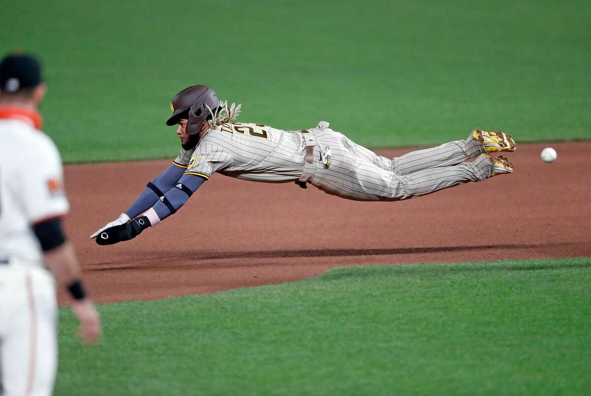 San Diego Padres' Fernando Tatis, Jr. slides head first while stealing second base in 7th inning against San Francisco Giants during MLB game at Oracle Park in San Francisco, Calif., on Thursday, July 30, 2020.