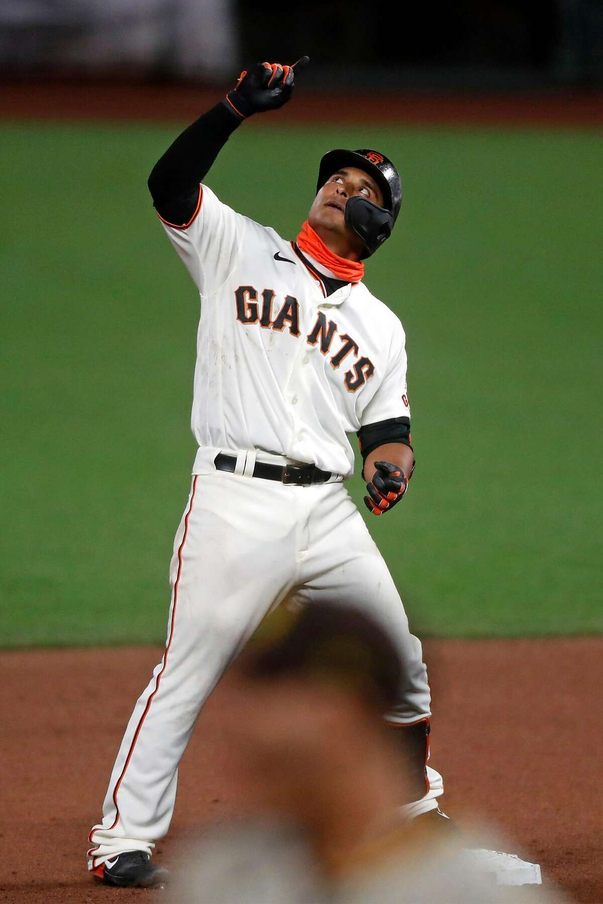 San Francisco Giants' Donovan Solano reacts to his RBI double in 7th inning against San Diego Padres during MLB game at Oracle Park in San Francisco, Calif., on Thursday, July 30, 2020.