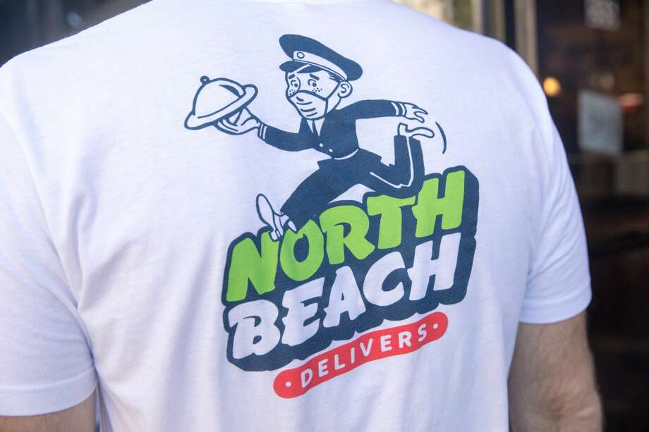 A group of volunteers known as 'North Beach Delivers' offer free delivery services for local restaurants impacted by the COVID-19 coronavirus, connecting them with customers in the North Beach neighborhood of San Francisco on July 30, 2020. Photo: Douglas Zimmerman/SFGATE / SFGATE