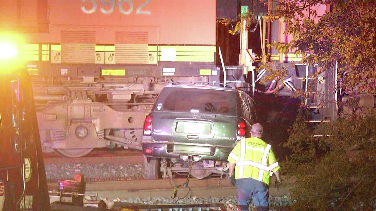 San Antonio police are trying to locate four people who ran from the scene after their vehicle hit a moving train Thursday night.