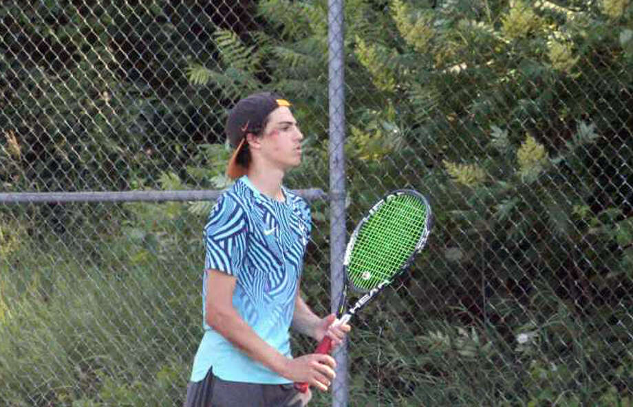 Big Rapids' No. 1 singles player Owen Westerkamp gets ready for a workout during a recent practice at Hemlock Park. Photo: Pioneer Photo/John Raffel