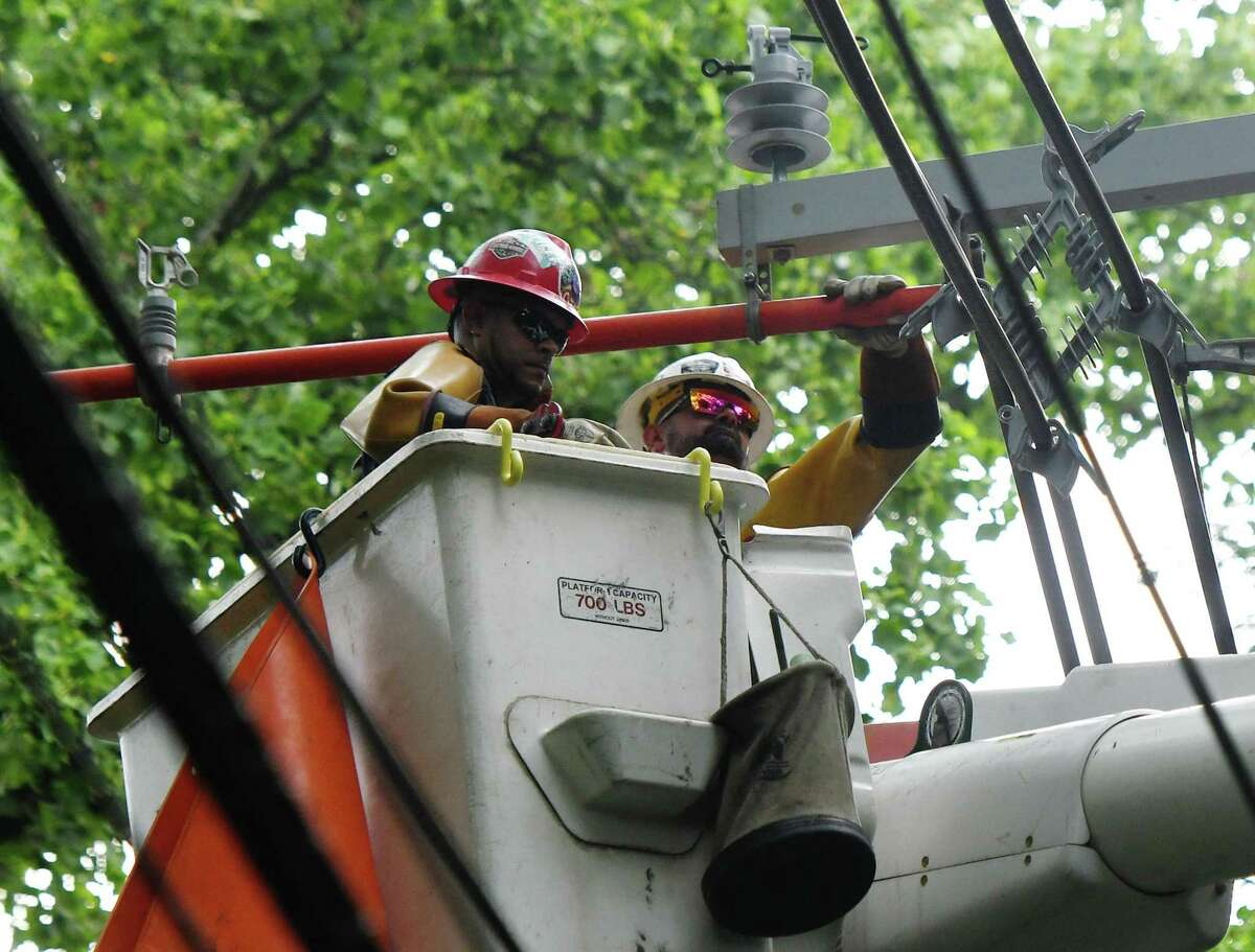Crews work on Eversource lines in July 2019 in Greenwich, Conn.
