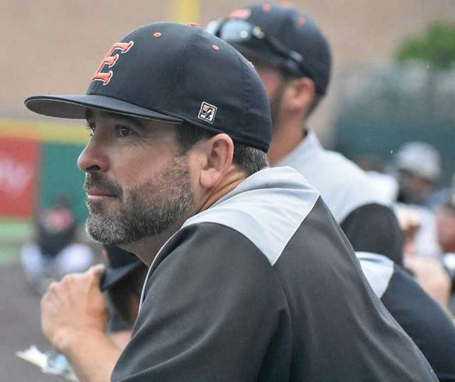 Edwardsville baseball coach Tim Funkhouser watches from the dugout during the Class 4A state championship game against St. Charles North in Joliet.