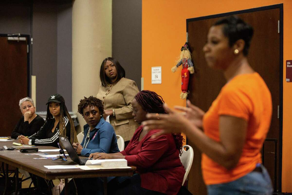 Angeanette Thibodeaux and other members of the Acres Homes Super Neighborhood Council listen to candidate Renee Jefferson-Smith address the controversy over the stalled District B runoff last November.