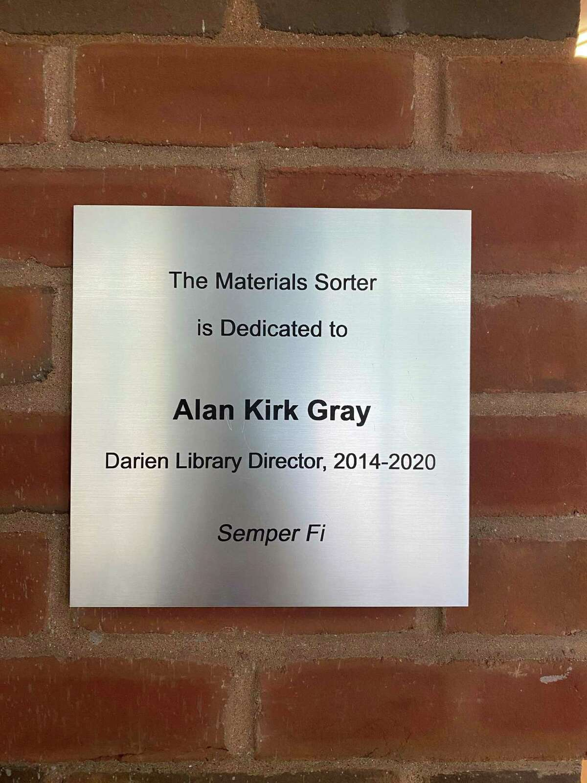 The library's new indoor automatic book returns machine is dedicated to Alan Kirk Gray.