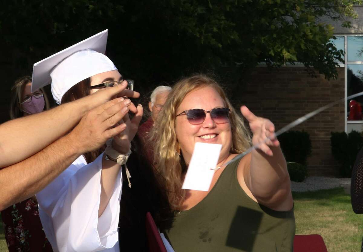 Cass City Graduation was held July 30 in front of the high school. Graduates, friends, and family participated in a drive-thru ceremony in which students accepted their diploma, took photos, and parents released a balloon to symbolize letting their childgo.