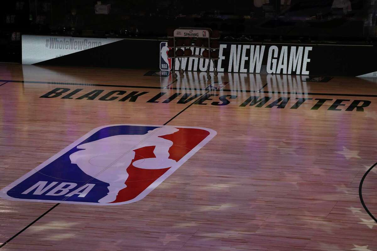 A general view of the court with Black Lives Matter written above the NBA logo is seen at center court prior to an NBA basketball game between the Los Angeles Clippers and the Los Angeles Lakers, Thursday, July 30, 2020, in Lake Buena Vista, Fla. (Mike Ehrmann/Getty Images via AP, Pool)