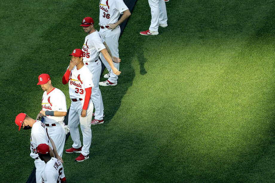 Cardinals players line up prior to last Friday's opener against the Pirates in St. Louis. Friday's Cardinals game at Milwaukee was postponed after two Cardinals tested positive for COVID-19. Photo: AP Photo