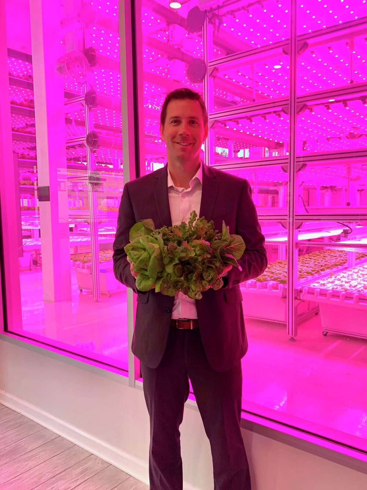 Daniel Malechuk is chief executive officer of Kalera, a technology-driven, vertical farming company that plans to open a Houston facility in 2021. Kalera will be able to grow 5 million pounds of lettuce - the equivalent of 15 million heads of lettuce - annually. Malechuk holds a head of lettuce at HyCube, Kalera's vertical farm on-site at the Marriott Orlando World Center.
