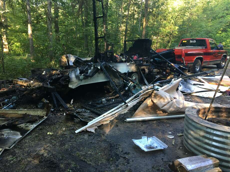 Troopers from the Michigan State Police Cadillac Post responded around 6:50 a.m. to Veterans Memorial State Forest Campground in Beulah for a camper trailer explosion and fire on Friday. Photo: Courtesy Photo/MSP