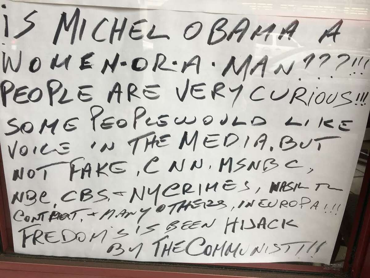 Handwritten signs posted in the windows of Cafe Pinocchio in San Francisco's North Beach create a stir.