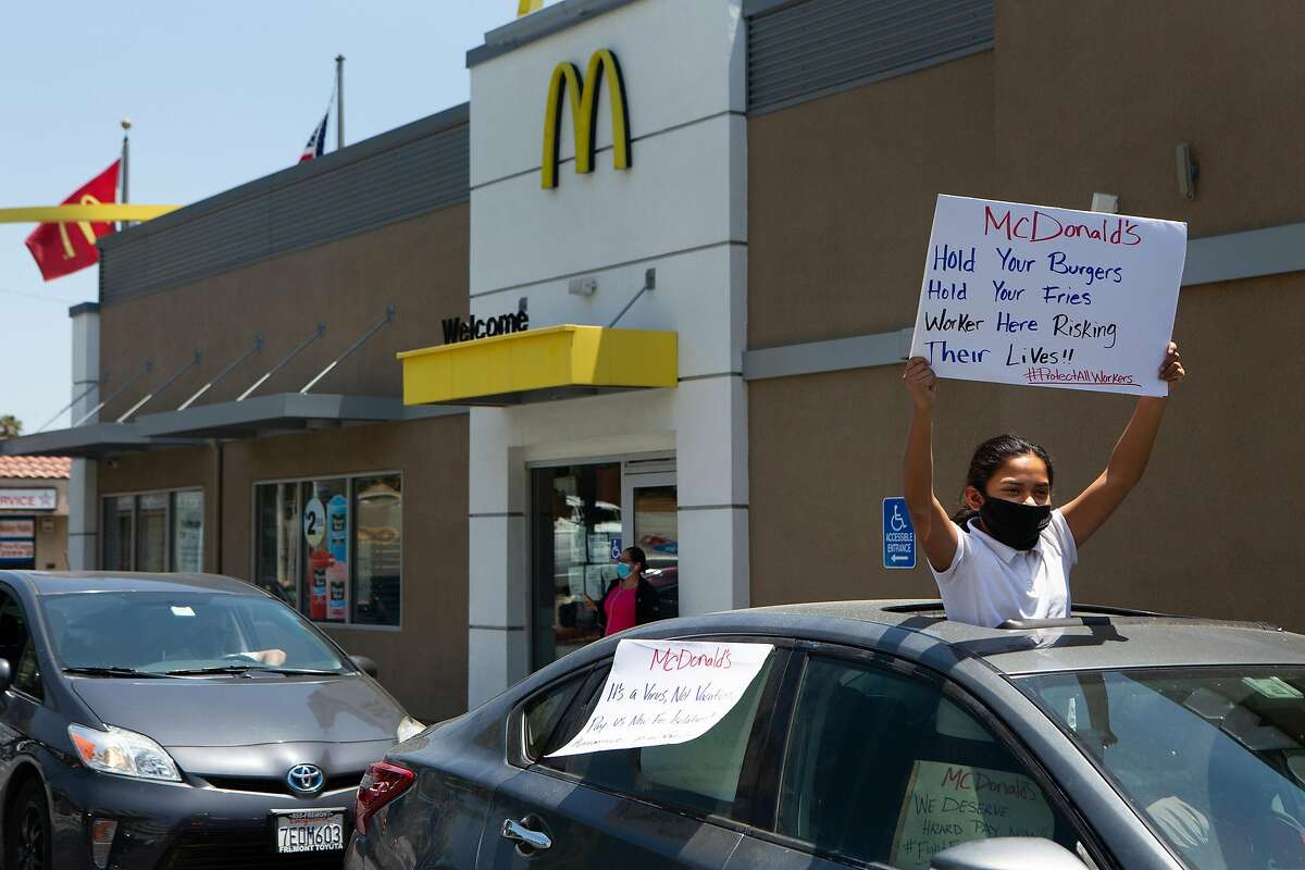 A protest in support of McDonald's workers at a drive-thru in Monterey Park, California, on May 20, 2020. (Gabriella Angotti-Jones/Los Angeles Times/TNS)