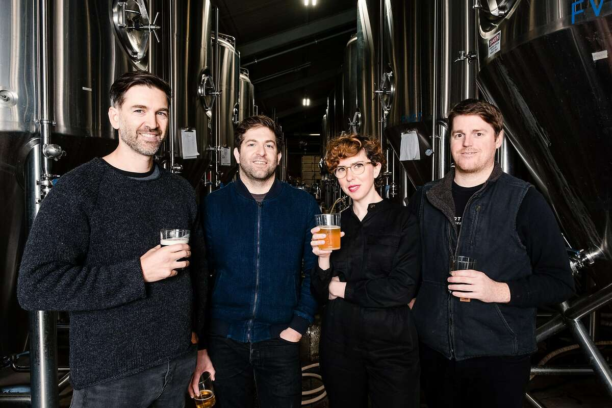 The original Fort Point Brewery team from left to right, Cofounders Tyler and Justin Catalana, creative director Dina Dobkin, and Director of brewing Mike Schnebeck are photographed at the Fort Point Brewery in San Francisco, Calif. on Sunday, January 26, 2020.