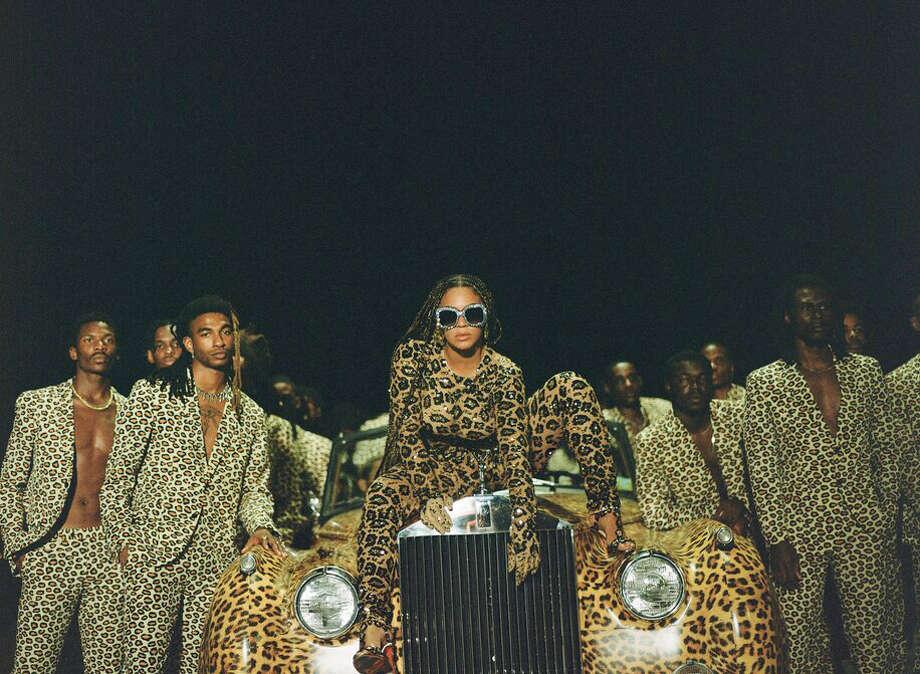 "Beyoncé Knowles-Carter, center, appears in her visual album ""Black Is King."" Photo: Travis Matthews/Parkwood Entertainment/Disney Plus / Travis Matthews/Parkwood Entertainment/Disney Plus"