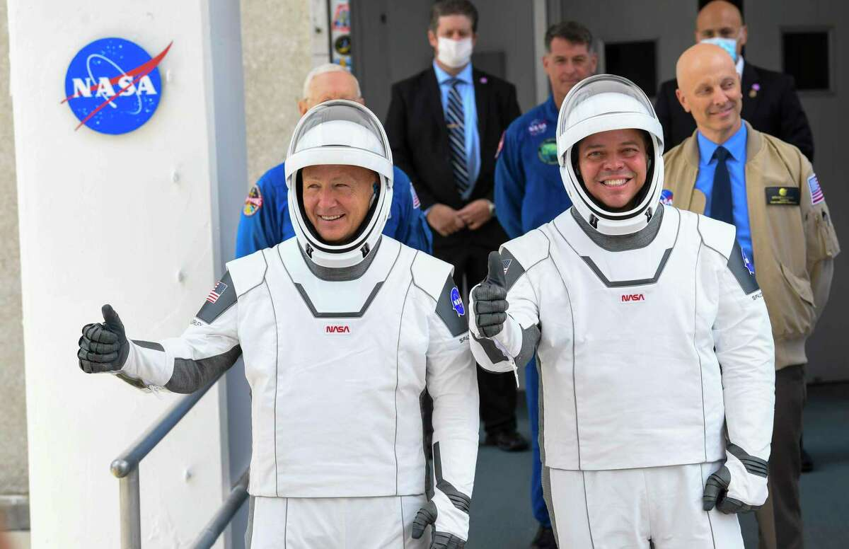NASA commercial crew astronauts Doug Hurley, left, and Bob Behnken leave for their flight aboard the SpaceX Falcon 9 rocket on May 27, 2020.