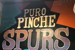 "One Spurs fan will be watching the team's Orlando bubble games with all the passion of Commerce Street honking and unrelenting Silver & Black pride thanks to his new ""Puro Pinche Spurs"" mural."