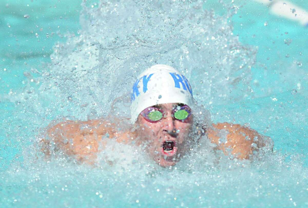 Julian Fraser of the Rocky Point Club competes in the boys 17 and under butterfly event during the Fairfield County Swimming League championship meet at the Roxbury Swim Club in Stamford, Conn., Saturday, Aug. 9, 2014.