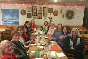 Deckerville League of Women pose for a photo in a restaurant.