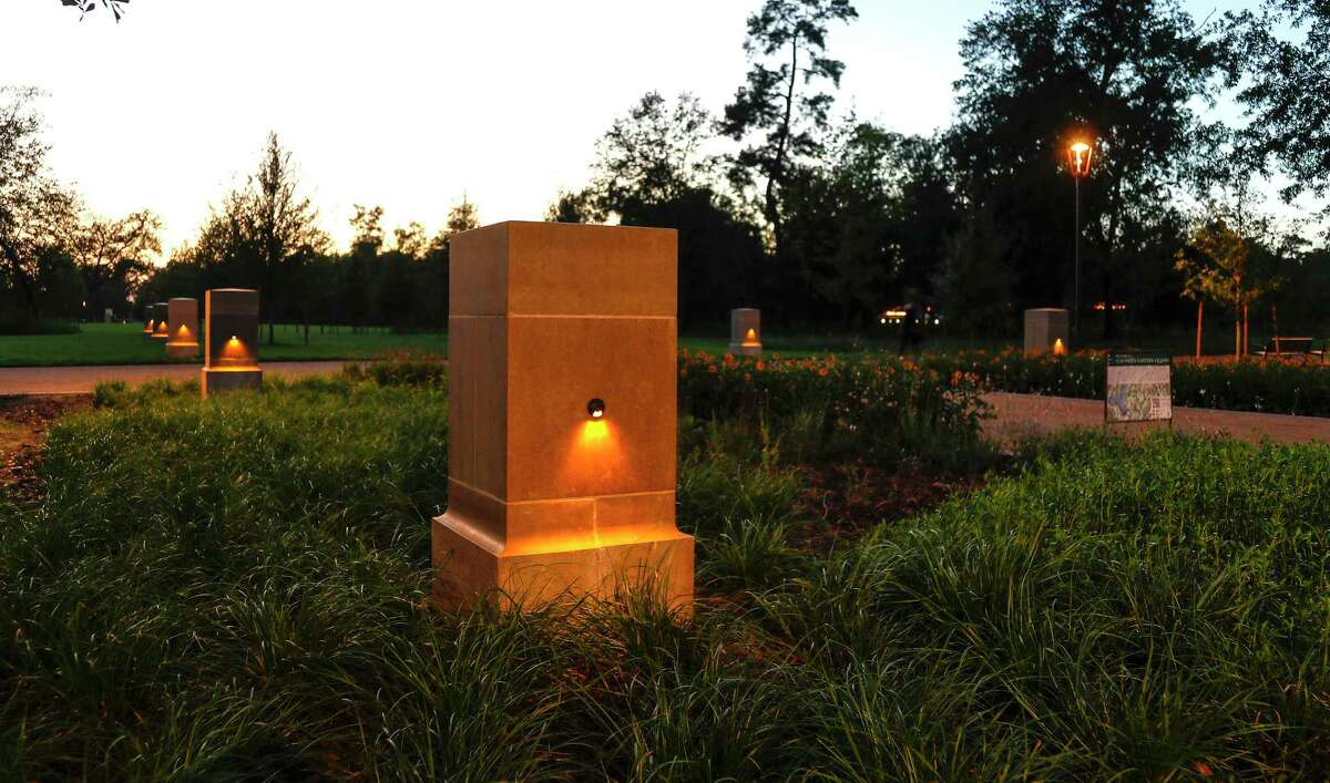 Dusk view of lights through the axis of limestone pedestals that run east-west across Memorial Park's new Eastern Glades, extending from the park entry at Crestwood to beyond Hines Lake, Thursday, July 30, 2020, in Houston.