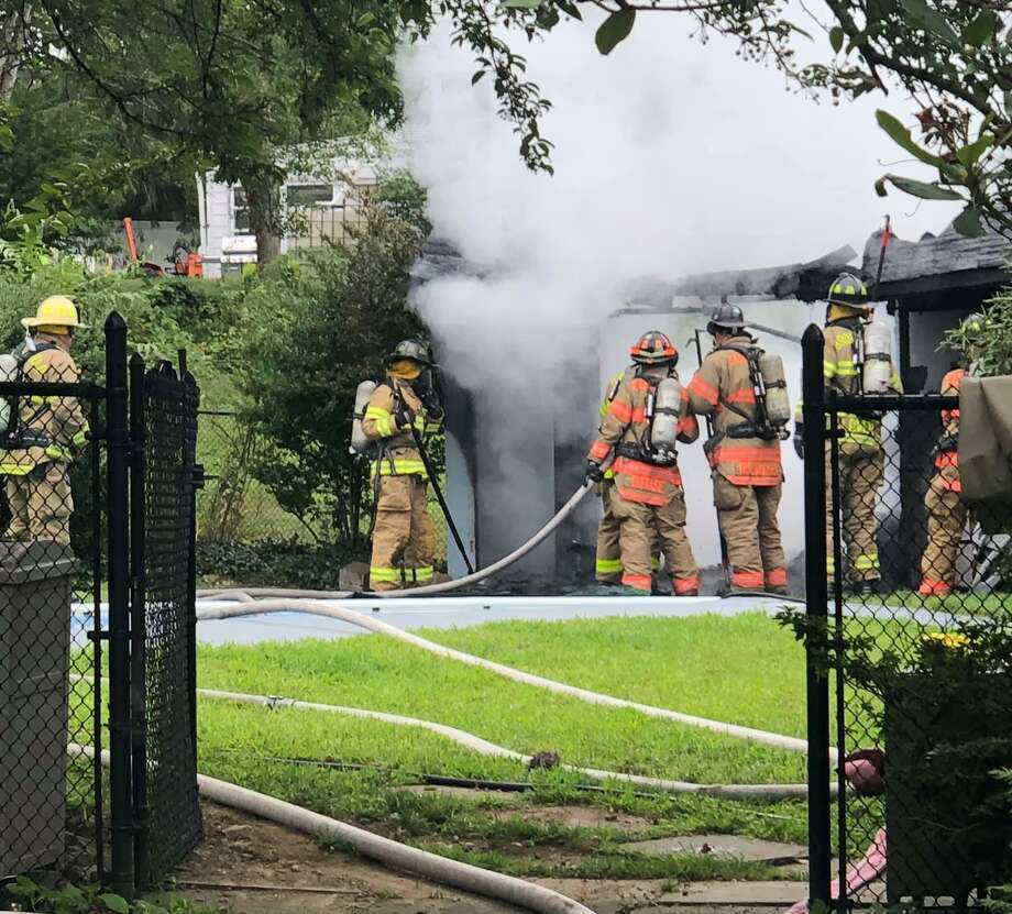 Firefighters at the scene of a pool house fire in Brookfield, Conn., the morning of July 31, 2020. Photo: Brookfield Vol. Fire Dept. Candlewood Company Inc.