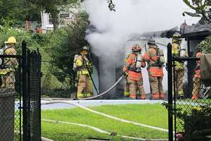 Firefighters at the scene of a pool house fire in Brookfield, Conn., the morning of July 31, 2020.