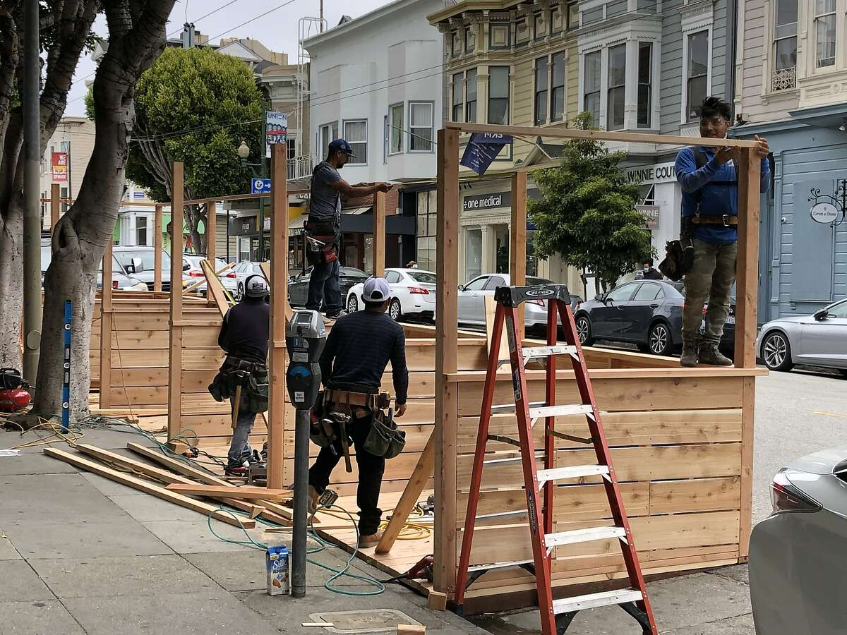 A dining platform under construction on Union Street in San Francisco on July 28, 2020. Similar nooks are springing up across the city and Bay Area as governments try to make it possible for restaurants and cafes to stay in business.