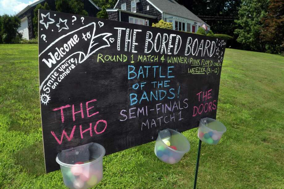 "The ""Bored Board"" in front of the Solomon home in Trumbull, Conn. July 29, 2020. Photo: Ned Gerard / Hearst Connecticut Media / Connecticut Post"