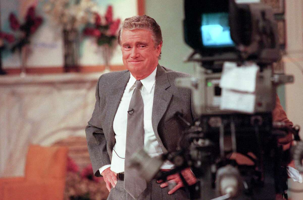 Regis Philbin, seen on the set of his talk show in 1999, was modest and self-deprecating, as familiar to viewers as their next-door neighbor.
