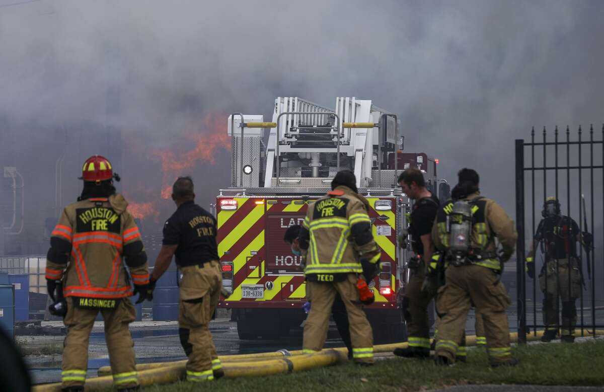 Firefighters battle a fire Friday, July 31, 2020, in the 7900 block of Westpark Dr. in Houston.
