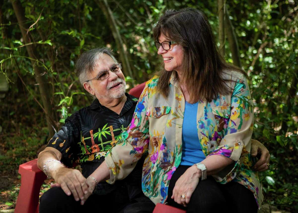 Michael McBride, 67, and his wife Kris McBride, 68, who donated her kidney to him, sit together at their backyard on Thursday in Conroe. After many obstacles delaying Michael McBride's kidney transplant, including the COVID-19 pandemic, his wive's breast cancer and a triple-bypass surgery he had to have, Kris was able to successfully donate her kidney to her husband in May.