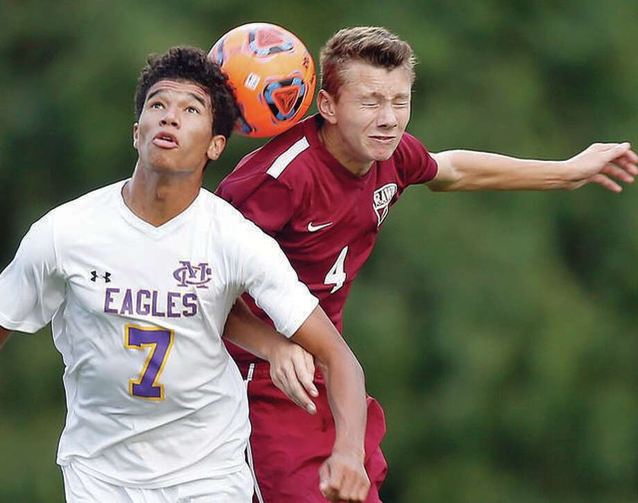 EA-WR's Ethan Moore, right, and CM's Jaydon Heeren battle for a headball during a 2017 game. The IHSA has moved boys soccer to spring 2021 because of the COVID-19 pandemic.
