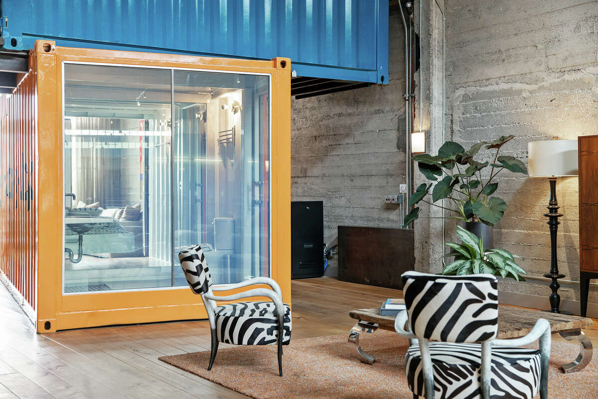 Custom artisan details abound, including two internal, customized cantilevered shipping containers.