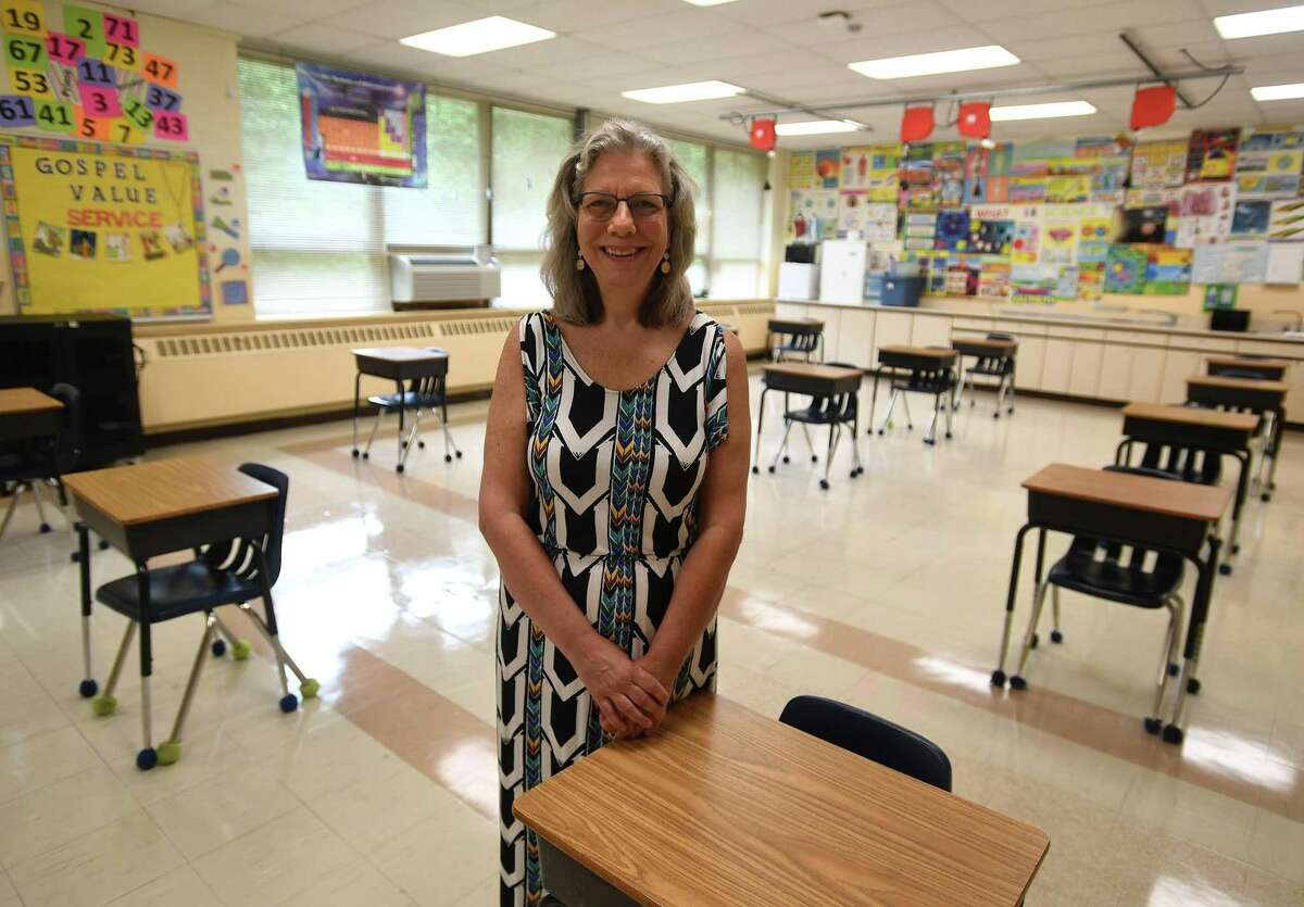 Lisa Lanni, head of school and principal at Holy Trinity Catholic Academy, in one of the school's socially distanced classrooms in Shelton, Conn. on Thursday, July 30, 2020. The school is opening on August 31 for in person instruction five days a week.