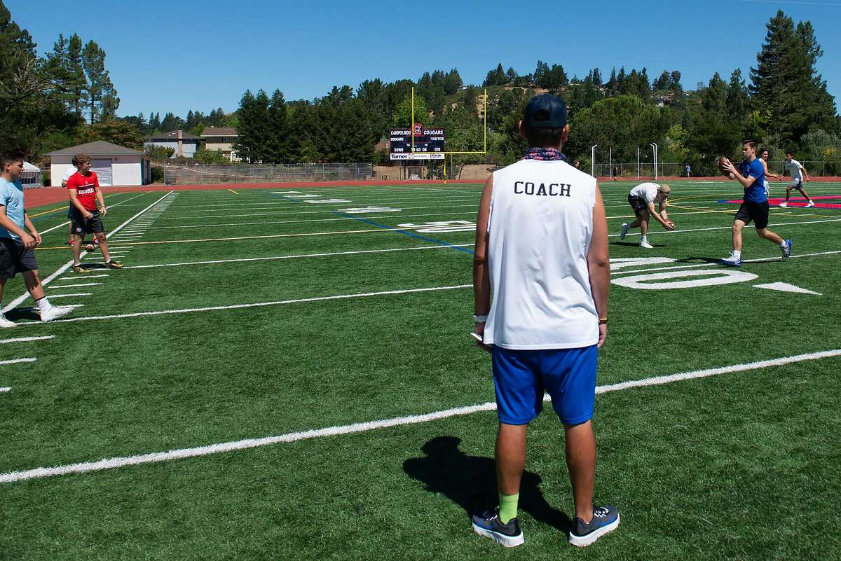 Will French, head of the Lamorinda Bomb Squad, coaches players at Campolinda High School, at Campolinda High School Stadium on July 31, 2020 in Moraga, Calif.