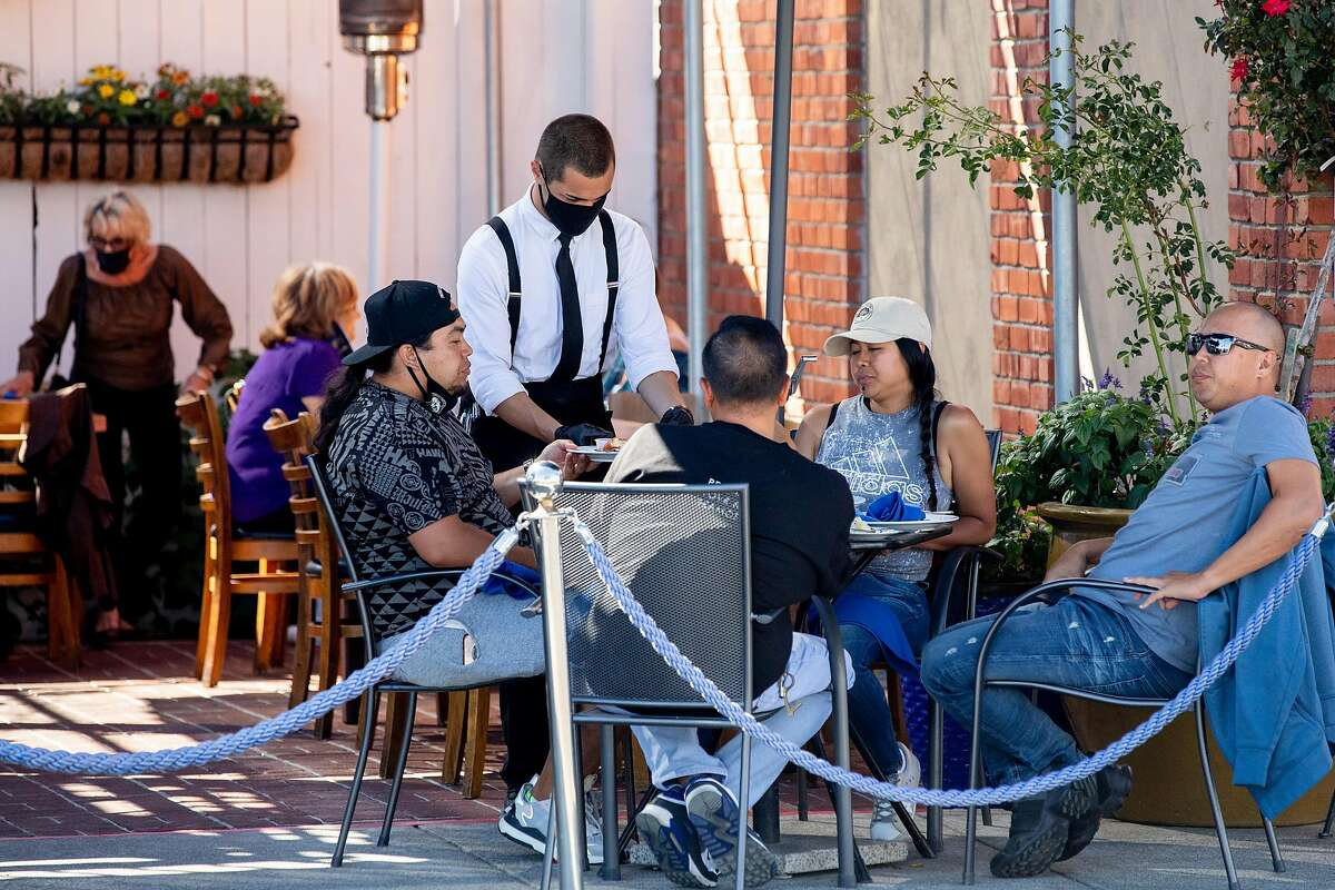 People dine outdoors at Sailor Jacks in Benicia in June. Solano is one of three Bay Area counties that currently allow outdoor dining.