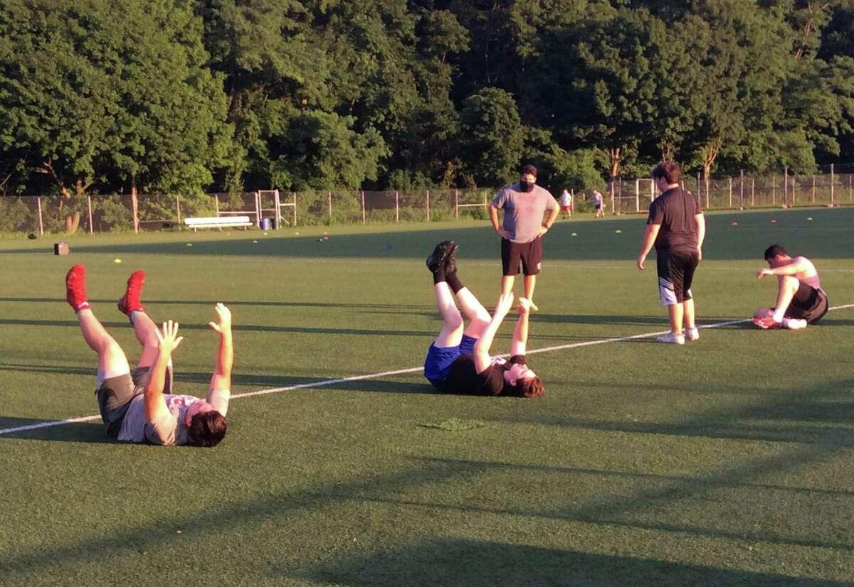 The Greenwich High School football teams works out at Greenwich High in Greenwich, Connecticut on Thursday, July 30, 2020.
