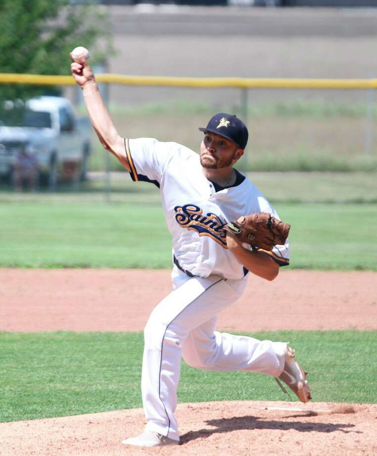 Manisteehurler Kyle Gorski fires a pitch against the Midland Tribe at Kliber Field during the regular season. Gorski was the starting pitcher for the Saints against the Flint Legends in Grand Rapids Friday. (News Advocate file photo)