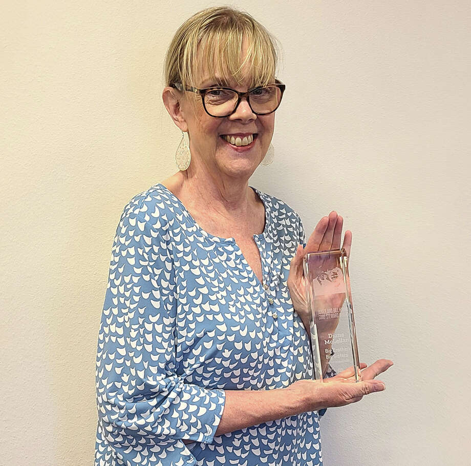 Diane McLellan, president of the board of Big Brothers Big Sisters of the Permian Basin, shows off the Janice and Bill Hanna Good Steward Award she received from the national organization. Photo: Courtesy Photo