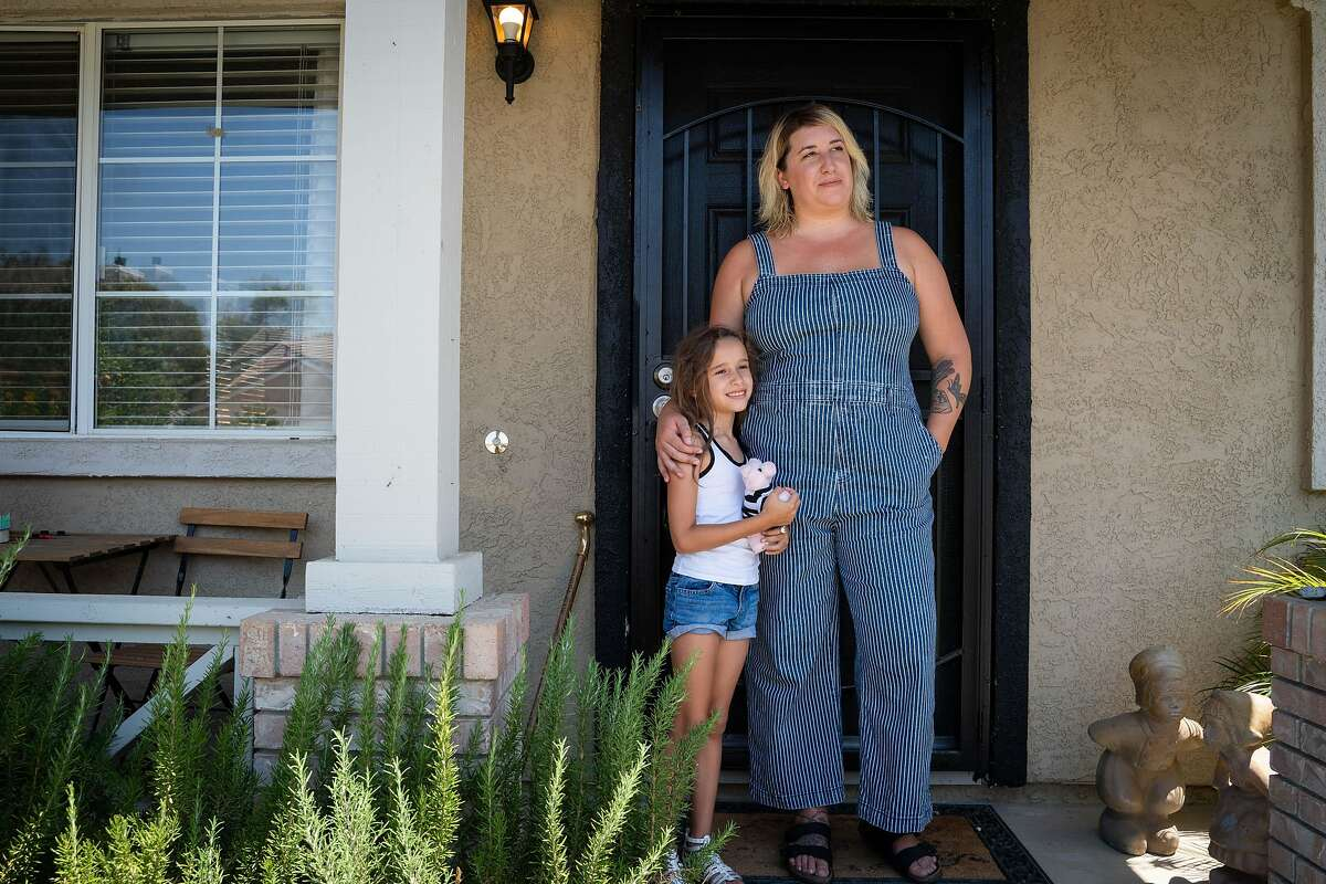 Delilah Lancaster, 6, left, and her aunt, Kristina Lancaster, 31, pose for a photo at Kristina's brother's home in Brentwood, Calif., on Monday, July 27, 2020. After losing work as a hair stylist due to the coronavirus pandemic, it took four months until Lancaster received any of her unemployment benefits. Lancaster plans to stay with family and friends in Brentwood, San Francisco and Oregon over the coming months.