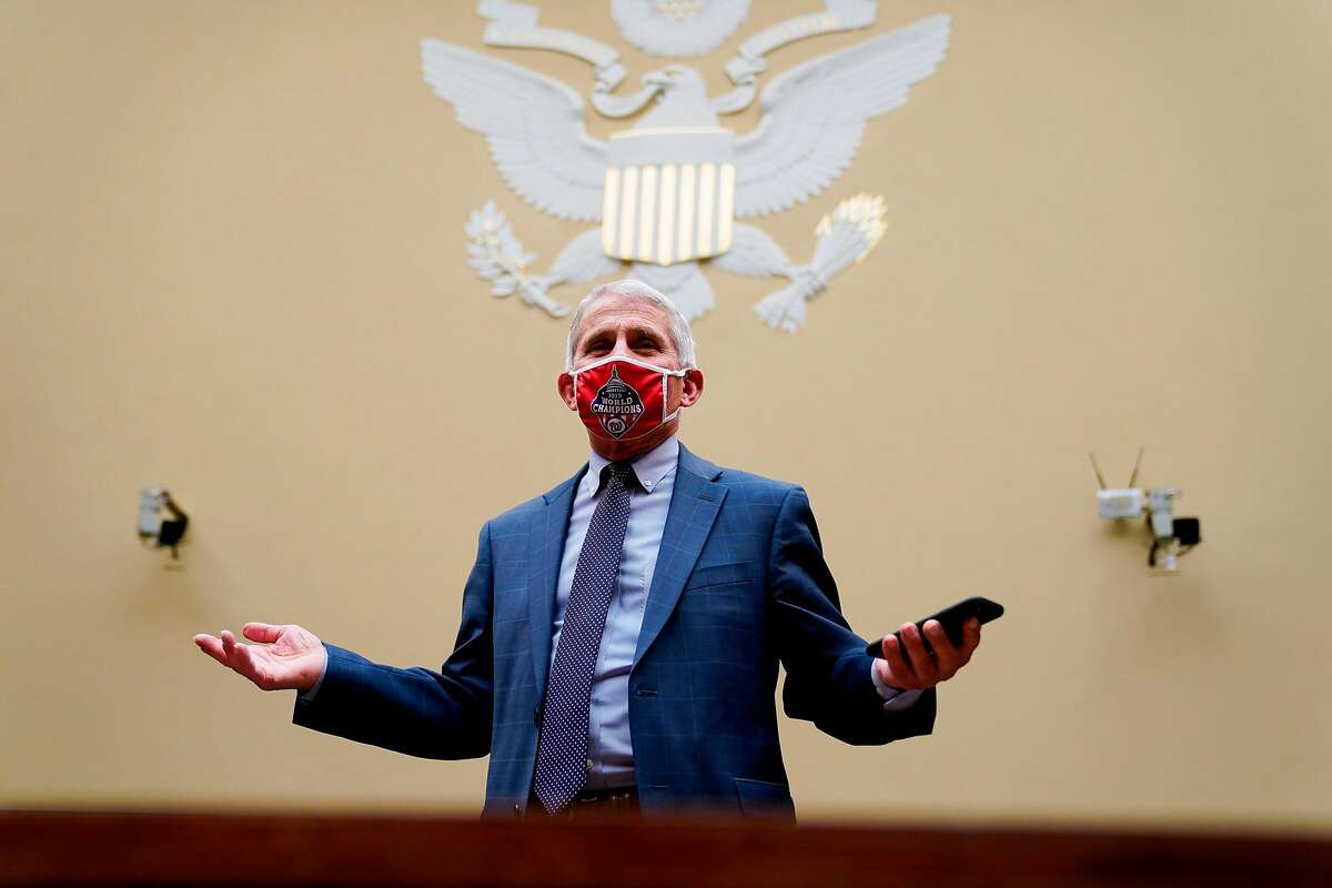 """Anthony Fauci, director of the US National Institute of Allergy and Infectious Diseases, wears a Washington Nationals protective mask while arriving to a House Select Subcommittee on the Coronavirus Crisis hearing titled """"The Urgent Need for a National Plan to Contain the Coronavirus"""" in Washington, DC on Friday, July 31, 2020. (Photo by Erin Scott / Pool / AFP) (Photo by ERIN SCOTT/Pool/AFP via Getty Images)"""