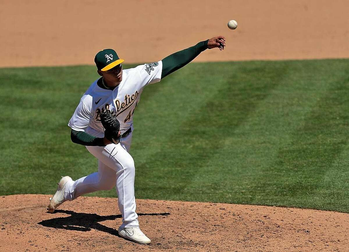 Jesus Luzardo pitches in the ninth inning as the Oakland Athletics played the Colorado Rockies at the Coliseum in Oakland, Calif., on Wednesday, July 29, 2020.