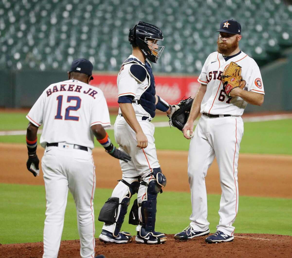 Houston Astros manager Dusty Baker Jr. walks out to the mound to retrieve pitcher Cy Sneed after he gave up a two-run homer to Los Angeles Dodgers Edwin Rios during the thirteenth inning of an MLB baseball game at Minute Maid Park, Wednesday, July 29, 2020, in Houston.