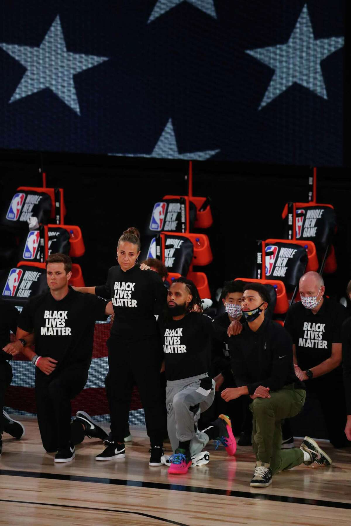 While Spurs assistant coach Becky Hammon and coach Gregg Popovich stood for the national anthem, the players took a knee. Most players and coaches also wore Black Lives Matters shirts.